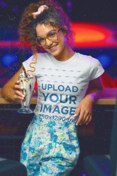 Retro T-Shirt Mockup Featuring a Woman Holding a Milkshake m11597