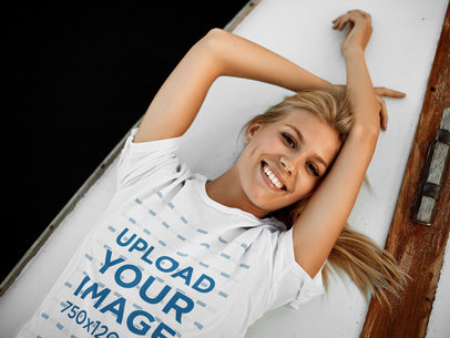 T-Shirt Mockup of a Woman Lying on a Boat's Deck m7812-r-el2