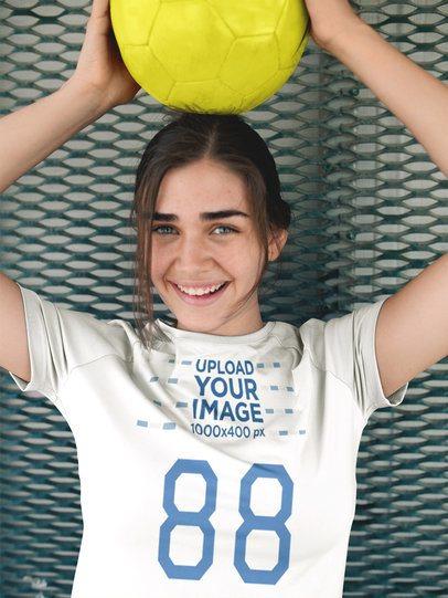 Custom Soccer Jerseys - Beautiful Girl Holding Ball on her Head a16523