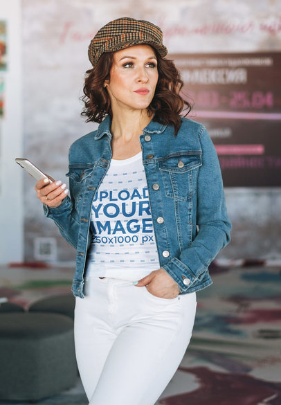 Tank Top Mockup Featuring a Serious Woman Holding Her Phone m7555-r-el2