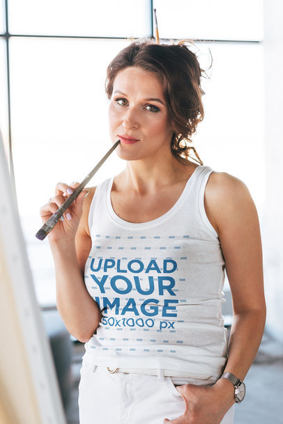 Tank Top Mockup of a Thoughtful Woman Painting a Picture M7558-r-el2