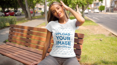 T-Shirt Video Featuring a Long-Haired Woman Sitting On a Park Bench 3471v