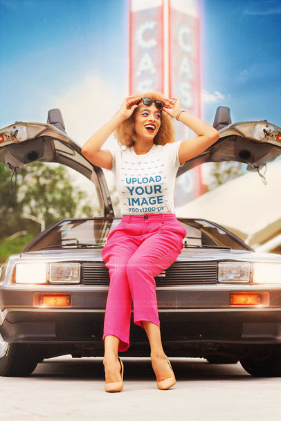 T-Shirt Mockup of a Woman in an 80s Outfit Posing By a Retro Car m12014