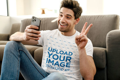 T-Shirt Mockup Featuring a Happy Man Taking a Selfie Making a Peace Sign M11003-r-el2