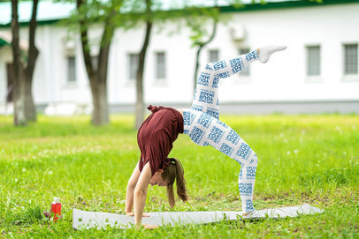 Sublimated Leggings Mockup of a Young Woman Doing Yoga at a Park m11309-r-el2