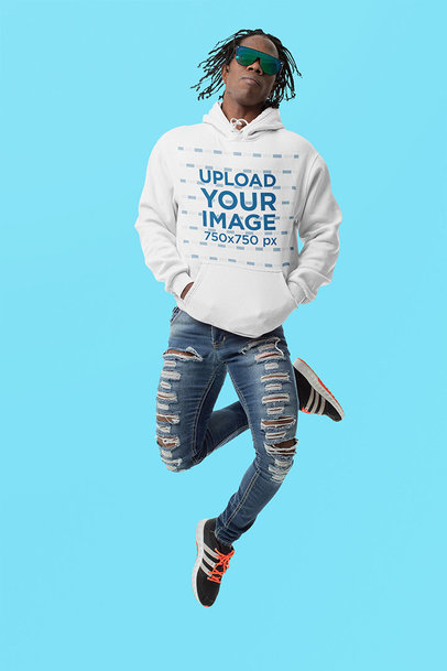 Hoodie Mockup of a Man With Sunglasses Jumping Against a Solid Color Backdrop m10776