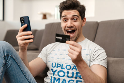 T-Shirt Mockup of an Excited Man Paying With His Phone M11002-r-el2