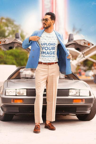 T-Shirt Mockup of a Stylish Man Posing by a Retro Car m12019