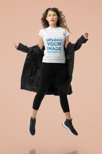 T-Shirt Mockup of a Wavy-Haired Woman Jumping in a Studio M10744