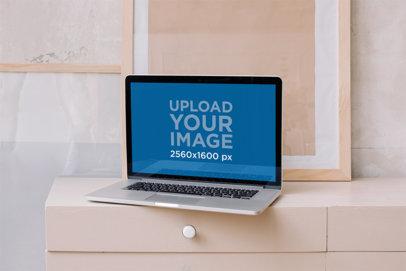 Mockup of a MacBook on a Peach-Colored Desk m11444-r-el2