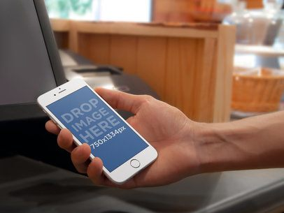 Mockup of a White iPhone 6 At Small Business Counter Bar