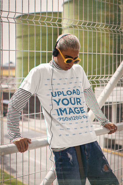 Basic T-Shirt Mockup Featuring a Man in a 90s Outfit Listening to Music m12502