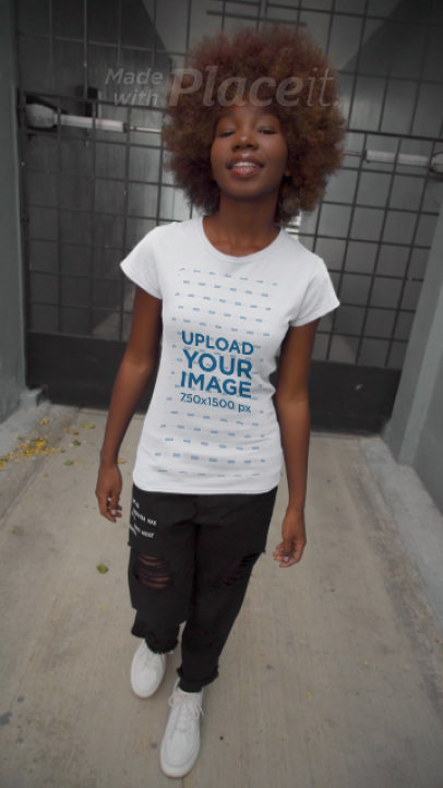 Video of a Young Woman Wearing a T-Shirt in an Urban Setting 3656v