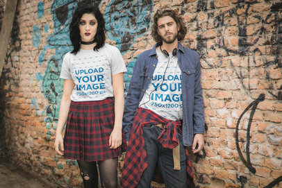 T-Shirt Mockup of a Couple Wearing Dark Grunge-Inspired Outfits M12541
