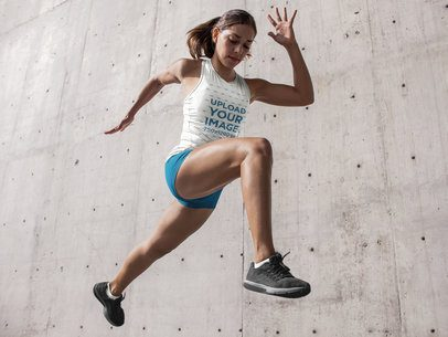 Track and Field Uniforms - Runner Woman Jumping Against Concrete Wall a16730