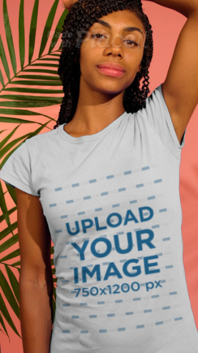 T-Shirt Video Featuring a Young Woman Posing With Some Plants 3728v