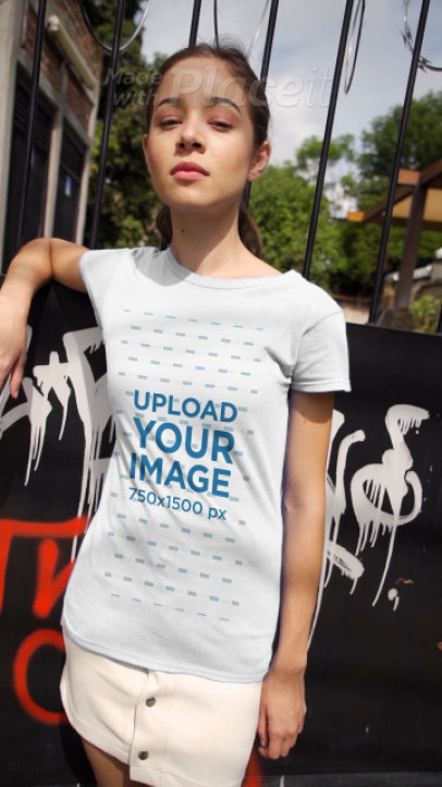 T-Shirt Video of a Young Woman in Front of a Wall With Graffiti 3673v