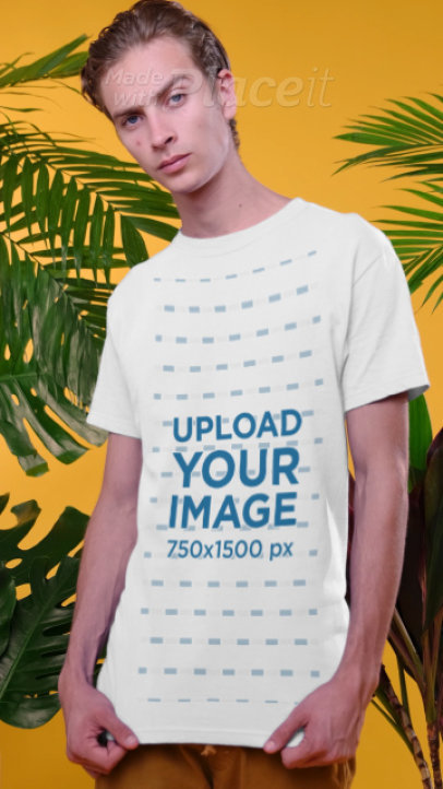 T-Shirt Video of a Man Posing by Some Palm Leaves 3736v
