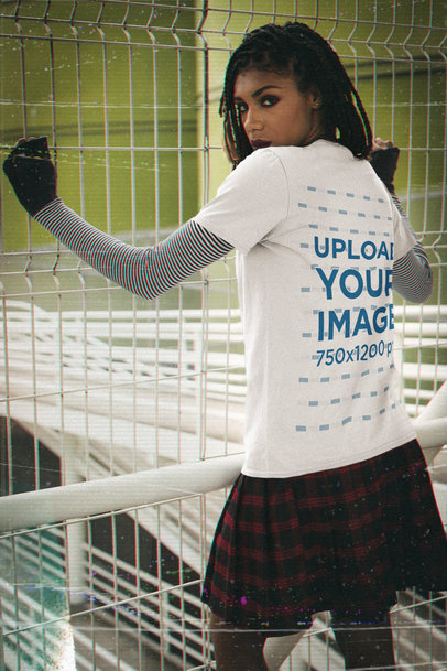 Back View T-Shirt Mockup Featuring a Serious Woman in a 90s Outfit m12521