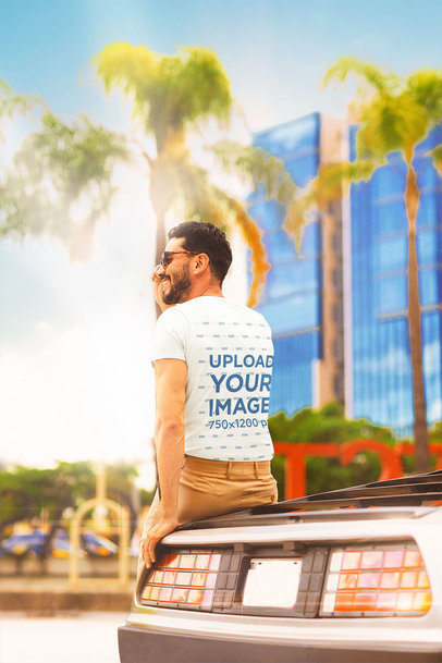 Back-View Tee Mockup of a Man Sitting on a Retro Automobile m12028