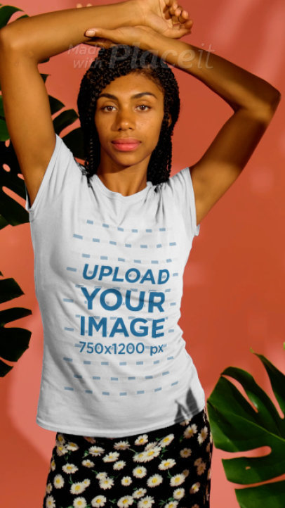T-Shirt Video Featuring a Happy Young Woman Posing by Some Tropical Plants 3731v