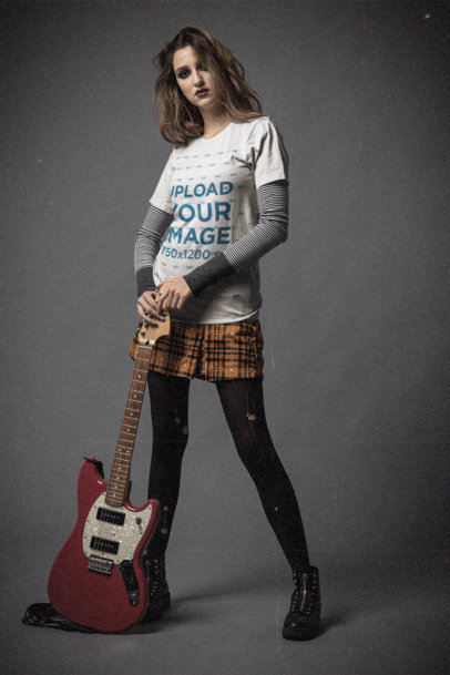 Bella Canvas T-Shirt Mockup of a Young Woman Posing With an Electric Guitar m12749