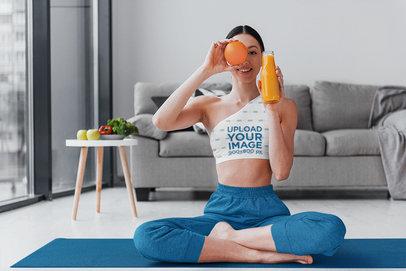One-Shoulder Sports Bra Mockup of a Woman Posing with Orange Juice M9316-r-el2
