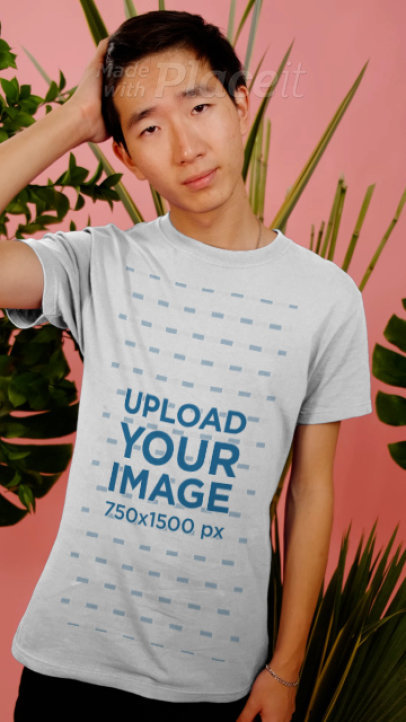 T-Shirt Video Featuring a Young Man Posing by Tropical Plants 3901v