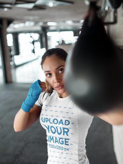 Girl Striking the Pear at the Gym While Wearing Custom Sportswear Mockup a16830