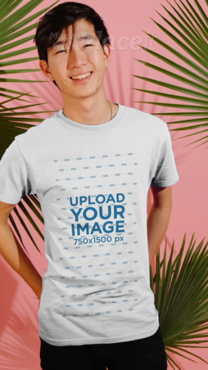 T-Shirt Video Featuring a Happy Young Man Surrounded by Palm Leaves 3899v