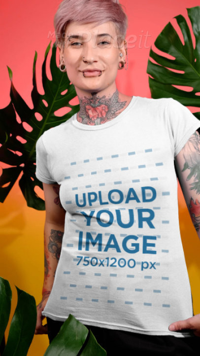 T-Shirt Video of a Tattooed Woman Posing by Palm Leaves 3895v