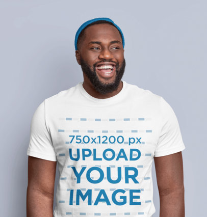 T-Shirt Mockup of a Man With a Beard Laughing in a Studio m3590-r-el2