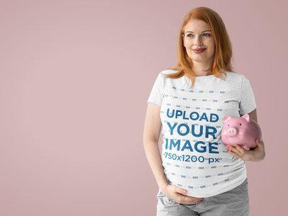 Heather T-Shirt Mockup of a Pregnant Woman Holding a Piggy Bank at a Studio m12730-r-el2