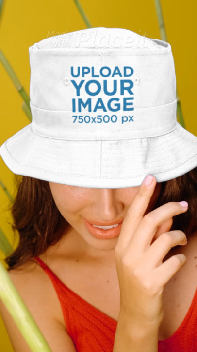 Video of a Woman Wearing a Customizable Bucket Hat at a Studio 3906v