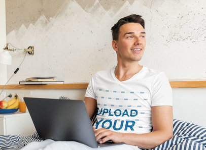 V-Neck Tee Mockup of a Young Man Working in Bed m15516-r-el2