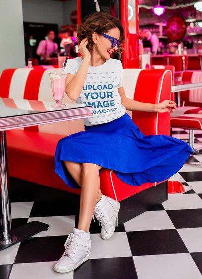Retro Mockup of a Woman Wearing a T-Shirt at a Milkshakes Restaurant m15500-r-el2