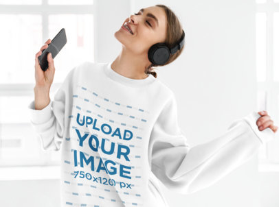 Sweatshirt Mockup of a Smiling Woman Listening to Music in Her Cellphone M10970-r-el2