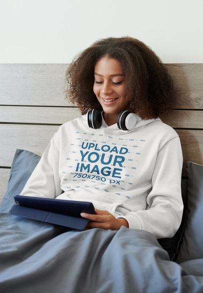 Hoodie Mockup of a Young Woman Enjoying Some Music in Bed M16246-r-el2
