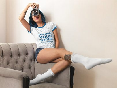Hispanic Woman Having Fun with a Camera While Wearing a Ringer Tshirt Mockup a16993