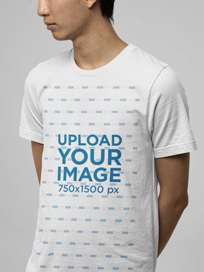 Round-Neck Bella Canvas Tee Mockup Featuring a Man at a Studio m13920
