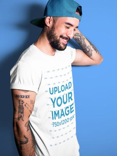 Happy Middle Aged Tattooed Guy Wearing a T-Shirt Mockup at a Studio a17019