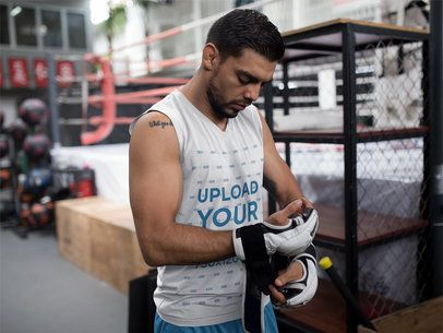 Mockup of an MMA Fighter Putting his Gloves While Wearing Custom Sportswear a17037