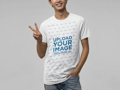 Bella Canvas T-Shirt Mockup of a Man Making a Peace Sign m13919
