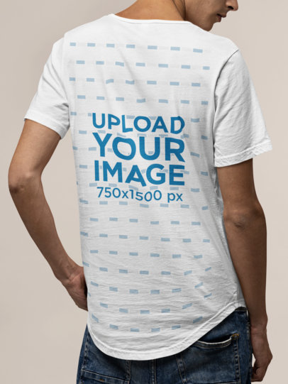 Mockup of the Back of a Slim Man Wearing a Bella Canvas Tee in a Studio M13900