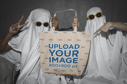 Sublimated Tote Bag Mockup Featuring Two Friends in Funny Ghost Costumes m16719