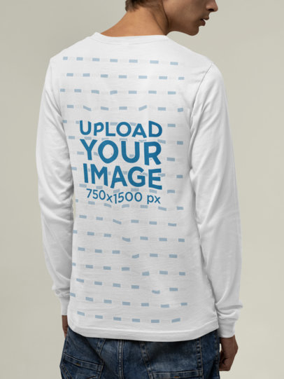 Back View Mockup of a Man Wearing a Bella Canvas Long Sleeve Tee at a Studio M13910