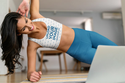Sports Bra Mockup of a Woman Doing a Side Plank at Home m16979-r-el2