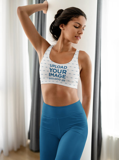 Sublimated Sports Bra Mockup Featuring a Woman Posing at Home m16772-r-el2