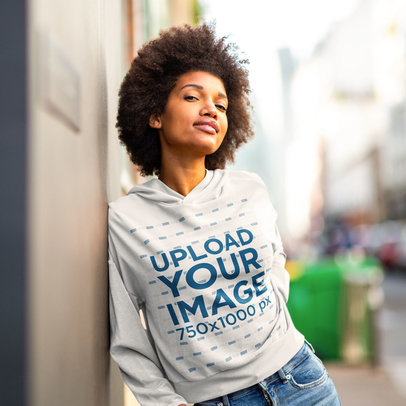 Heathered Hoodie Mockup Featuring a Young Woman Leaning Against a Wall m16904-r-el2