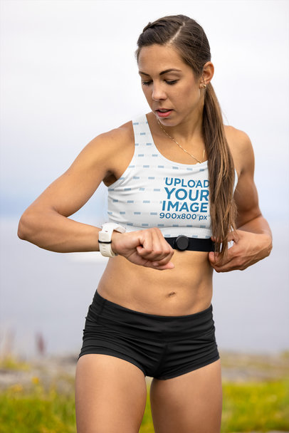 Sports Bra Mockup Featuring a Female Runner Checking Her Heart Rate m16673-r-el2
